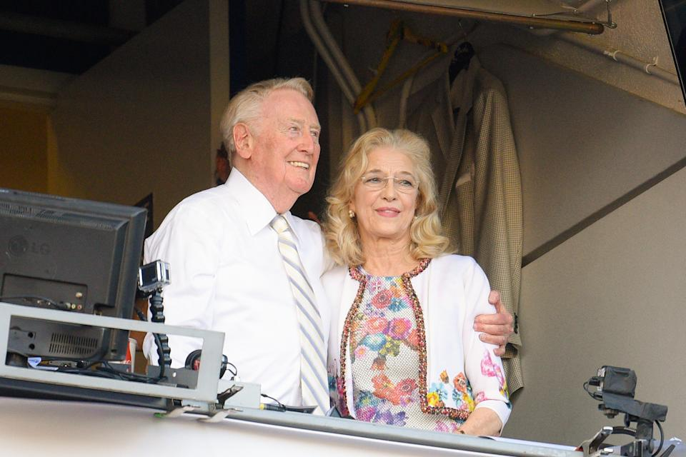 Los Angeles Dodgers announcer Vin Scully and his wife Sandra Hunt hug together after a 4-3 win over the Colorado Rockies at Dodger Stadium on September 25, 2016 in Los Angeles, California.  (Photo by Noel M Vasquez/Getty Images)