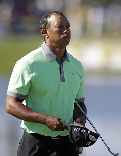 Tiger Woods exhales at the end of the third round of the Cadillac Championship golf tournament Saturday, March 8, 2014, in Doral, Fla. (AP Photo/Wilfredo Lee)