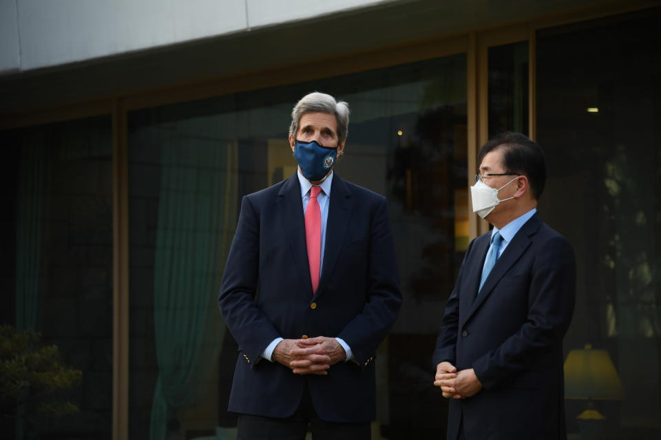 In this photo provided by U.S. Embassy Seoul, U.S. Special Presidential Envoy for Climate John Kerry, left, talks with South Korean Foreign Minister Chung Eui-yong upon his arrival for the banquet at the Foreign Minister's residence in Seoul, South Korea, Saturday, April 17, 2021. (U.S. Embassy Seoul via AP)