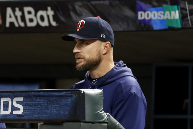 Minnesota Twins manager Rocco Baldelli watches from the dugout during the eighth inning in Game 3 of a baseball American League Division Series against the New York Yankees, Monday, Oct. 7, 2019, in Minneapolis. (AP Photo/Jim Mone)