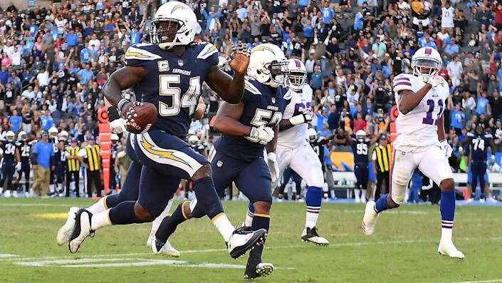 Chargers defensive end Melvin Ingram picks up a fumble by Bills quarterback Tyrod Taylor and scores a touchdown in the 3rd quarter.