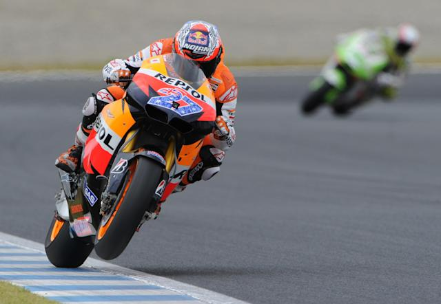 Casey Stoner (L) of Australia rides his Honda during the Moto GP class qualifying practice session of the motorcycle Grand Prix of Japan at Twin Ring Motegi circuit in Motegi on October 1, 2011. Australian Moto GP world championship leader Casey Stoner will start on pole at the Grand Prix of Japan after recording the fastest time in qualifying on October 1.AFP PHOTO / TOSHIFUMI KITAMURA (Photo credit should read TOSHIFUMI KITAMURA/AFP/Getty Images)