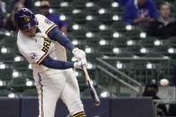 Milwaukee Brewers' Avisail Garcia hits a double during the first inning of a baseball game against the Chicago Cubs Wednesday, April 14, 2021, in Milwaukee. (AP Photo/Morry Gash)