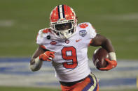 Clemson running back Travis Etienne (9) runs for a touchdown during the first half of the Atlantic Coast Conference championship NCAA college football game against Notre Dame, Saturday, Dec. 19, 2020, in Charlotte, N.C. Etienne was selected to The Associated Press All-America first-team offense, Monday, Dec. 28, 2020.(AP Photo/Brian Blanco)