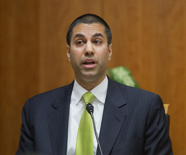"""FILE – In this Feb. 26, 2015, file photo, Federal Communication Commission Commissioner Ajit Pai speaks during an open hearing and vote on """"Net Neutrality"""" in Washington. (AP Photo/Pablo Martinez Monsivais, File)"""