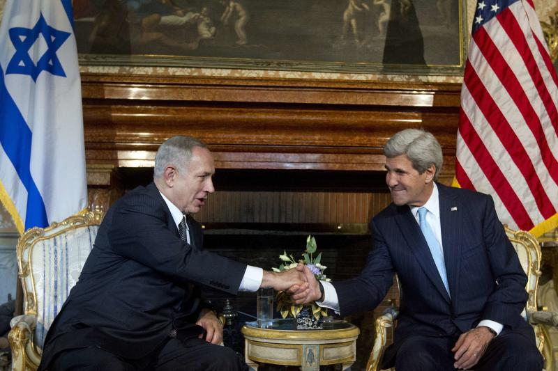 U.S. Secretary of State John Kerry shakes hands with Israeli Prime Minister Benjamin Netanyahu at Villa Taverna in Rome