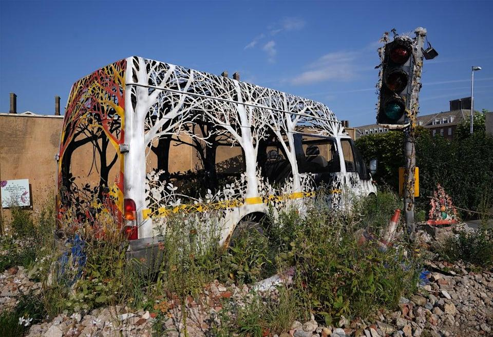 Another features a hand-cut repurposed van by artist Dan Rawlings, entitled Delays Expected, in the Saatchi Gallery garden (Yui Mok/PA) (PA Wire)