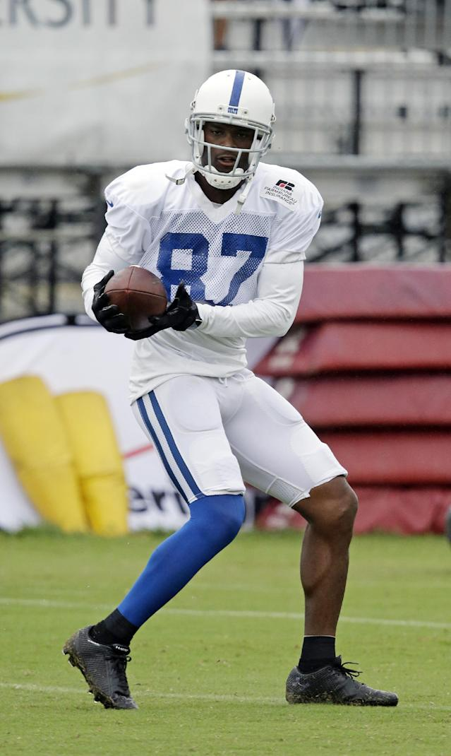 Indianapolis Colts wide receiver Reggie Wayne (87) makes a catch during NFL football training camp Tuesday, Aug. 12, 2014, in Anderson, Ind. (AP Photo/Darron Cummings)