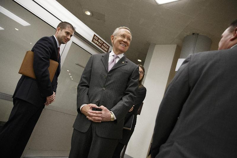 Senate Majority Leader Harry Reid of Nev. takes a break from the Senate floor, on Capitol Hill in Washington, Tuesday, Dec. 17, 2013, after a bipartisan budget compromise cleared a procedural hurdle, advancing past a filibuster threshold on a 67-33 vote that ensures the measure will pass the Democratic-led chamber no later than Wednesday and head to the White House to be signed into law. When enacted, the measure would ease for two years some of the harshest cuts to agency budgets required under automatic spending curbs commonly known as sequestration. (AP Photo/J. Scott Applewhite)