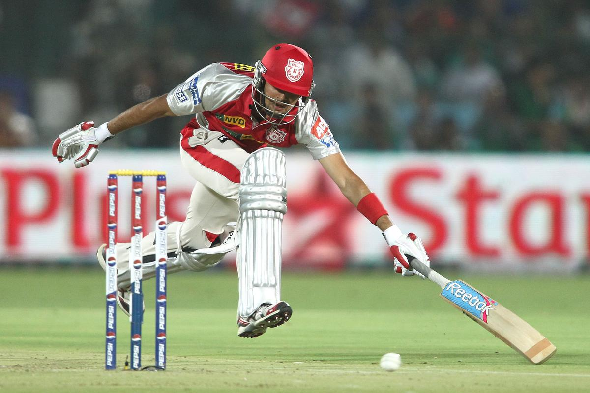 Manan Vohra of Kings XI Punjab scrambles to make his ground during match 18 of the Pepsi Indian Premier League (IPL) 2013 between The Rajasthan Royals and the Kings Xi Punjab held at the Sawai Mansingh Stadium in Jaipur on the 14th April 2013. (BCCI)
