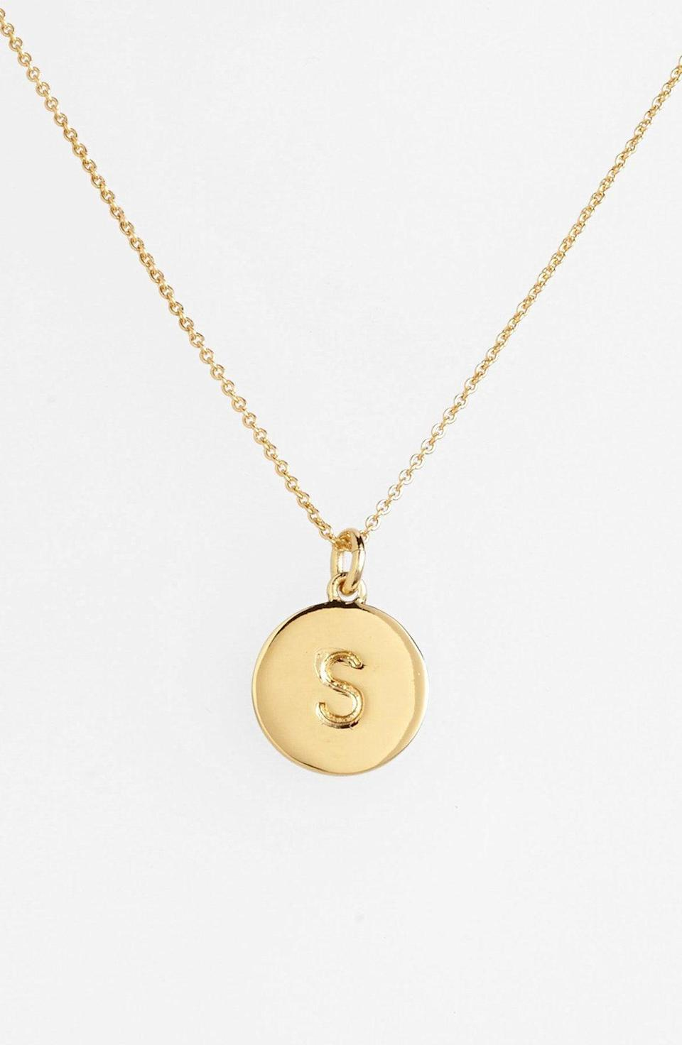 """<p><strong>Kate Spade </strong></p><p>nordstrom.com</p><p><strong>$40.60</strong></p><p><a href=""""https://go.redirectingat.com?id=74968X1596630&url=https%3A%2F%2Fwww.nordstrom.com%2Fs%2Fkate-spade-new-york-one-in-a-million-initial-pendant-necklace%2F3628637&sref=https%3A%2F%2Fwww.goodhousekeeping.com%2Fholidays%2Fgift-ideas%2Fg4349%2Fgifts-for-college-graduates%2F"""" rel=""""nofollow noopener"""" target=""""_blank"""" data-ylk=""""slk:Shop Now"""" class=""""link rapid-noclick-resp"""">Shop Now</a></p><p>This gold-plated initial necklace is chic enough for the office, but can also add subtle sparkle and shine to her everyday look. </p>"""