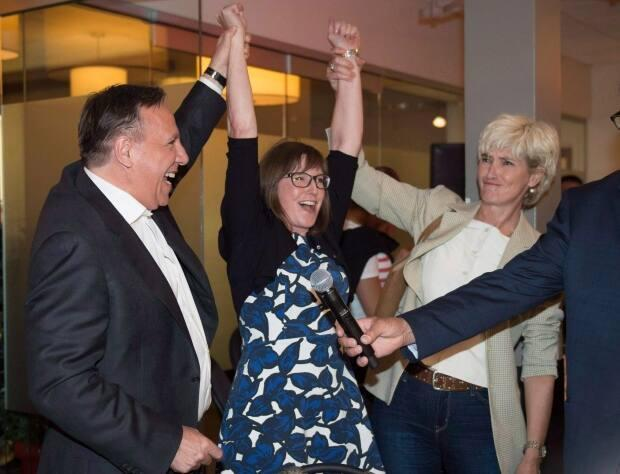 Proulx was among the original supporters of the Coalition Avenir Québec when Legault launched the party in 2011. She's seen here in a 2018 photo with Premier François Legault, left, and Legault's wife Isabelle Brais, right.
