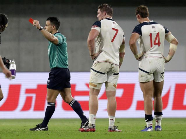 Referee Nick Berry shows a red card to United States' John Quill. centre, during the Rugby World Cup Pool C game at Kobe Misaki Stadium, between England and the United States in Kobe, Japan, Thursday, Sept. 26, 2019. (AP Photo/Aaron Favila)