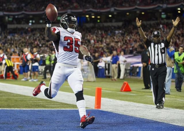 Atlanta Falcons Antone Smith celebrates his touchdown against the Buffalo Bills during the first half of NFL action in Toronto, Sunday Dec. 1, 2013. (AP Photo/The Canadian Press, Mark Blinch)