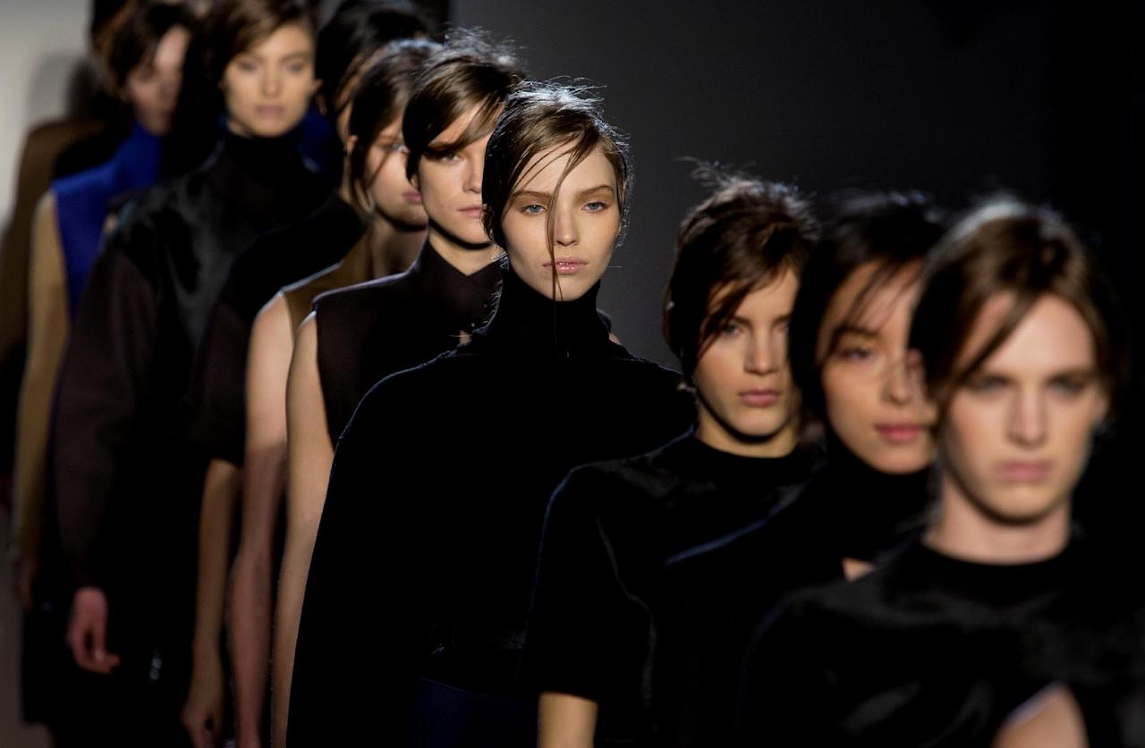 Models walk the runway during the Victoria Beckham Fall 2013 fashion show during Fashion Week, Sunday, Feb. 10, 2013, in New York. (AP Photo/Craig Ruttle)