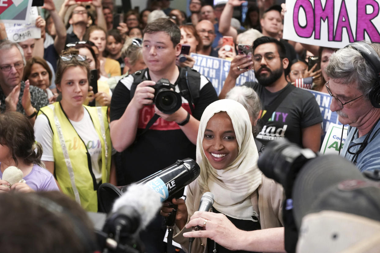 Rep. Ilhan Omar speaks to supporters as she arrives at Minneapolis-St. Paul International Airport on Thursday. (Photo: Glen Stubbe/Star Tribune via AP)