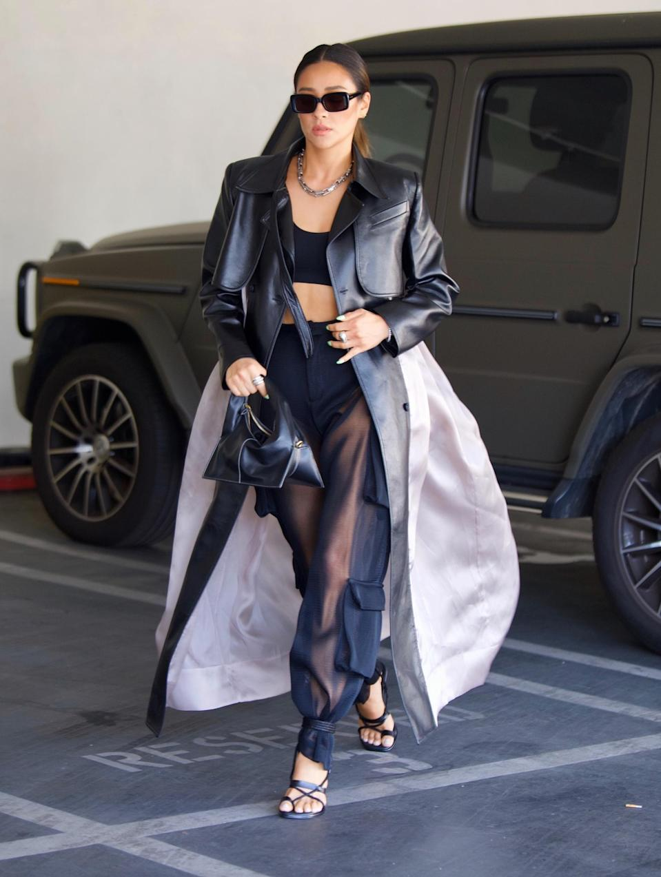 Shay Mitchell was spotted out in Beverly Hills on Tuesday as she headed to a meeting. The actress and model looked stylish in a Black crop top, cargo pants and a leather accented trench coat as she grabbed a few things from her car alongside an assistant. 25 May 2021 Pictured: Shay Mitchell. Photo credit: MEGA TheMegaAgency.com +1 888 505 6342 (Mega Agency TagID: MEGA757529_001.jpg) [Photo via Mega Agency]