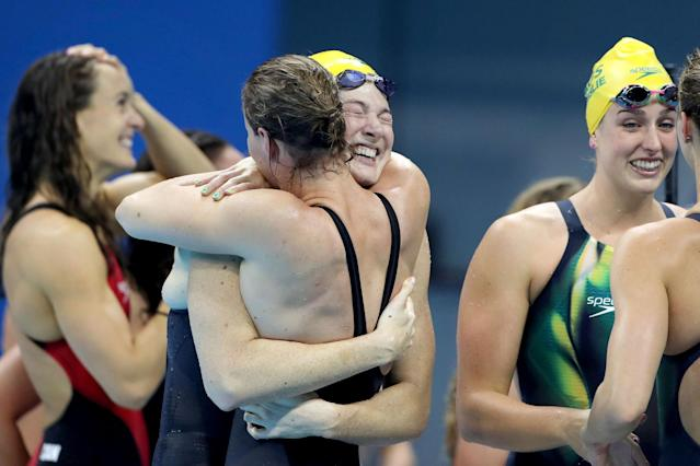 <p>Sisters Bronte Campbell and Cate Campbell, (facing), hug after winning the gold medal in world record time along with team mates Emma McKeon and Brittany Elmslie, in the Women's 4 x 100m Freestyle Relay Final during the swimming competition at the Olympic Aquatics Stadium August 6, 2016 in Rio de Janeiro, Brazil. (Photo by Tim Clayton/Corbis via Getty Images) </p>