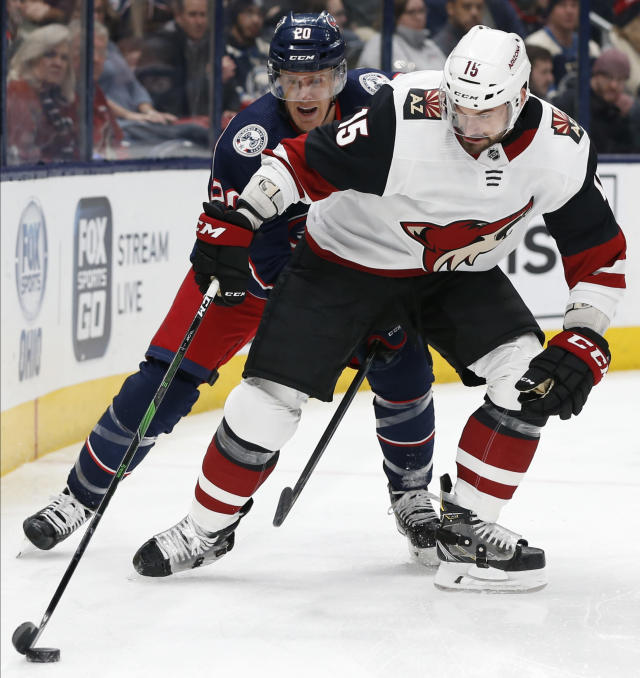 Columbus Blue Jackets' Riley Nash, left, tries to steal the puck from Arizona Coyotes' Brad Richardson during the first period of an NHL hockey game Tuesday, Dec. 3, 2019, in Columbus, Ohio. (AP Photo/Jay LaPrete)