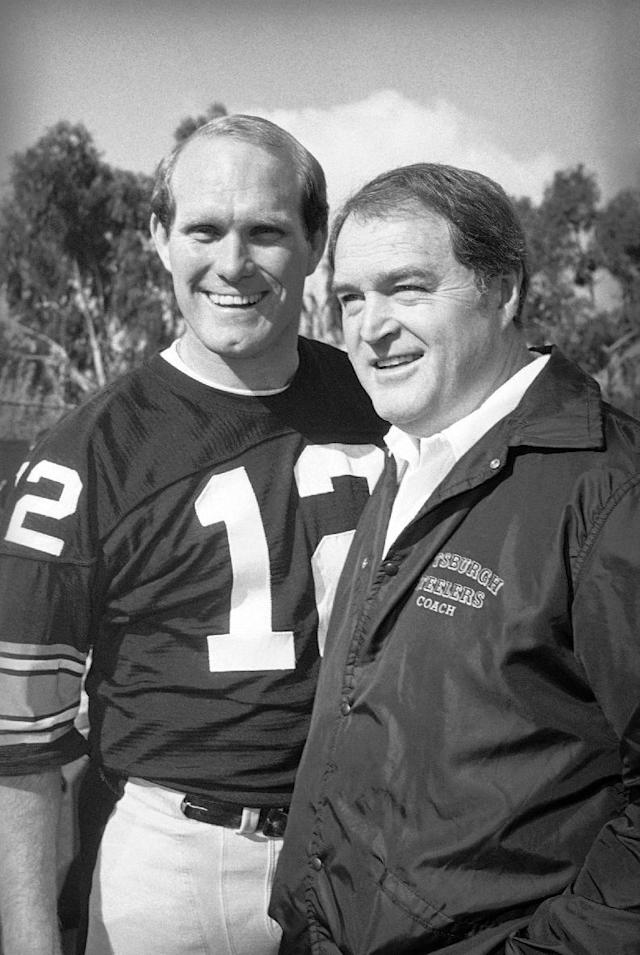 FILE - In this January 1980 file photo, Pittsburgh Steelers quarterback Terry Bradshaw, left, and coach Chuck Noll pose for photographers at NFL football Super Bowl XIV picture day in Fullerton, Calif. Noll, the Hall of Fame coach who won a record four Super Bowl titles with the Steelers, died Friday night, June 13, 2014, at his home. He was 82. The Allegheny County (Pa.) Medical Examiner said Noll died of natural causes. (AP Photo/File)