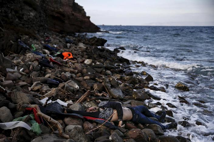 <p>The body of an unidentified refugee is seen on a beach after being washed ashore, on the Greek island of Lesbos, Nov. 7, 2015. <i>(Alkis Konstantinidis/Reuters)</i></p>