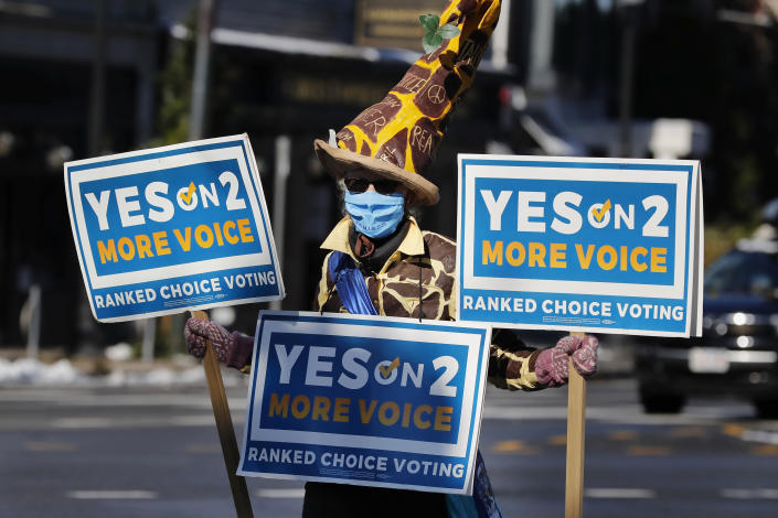 Eileen Ryan campaigns for ranked choice voting in costume on Oct. 31, 2020, in Cambridge, Mass. (Michael Dwyer/AP)