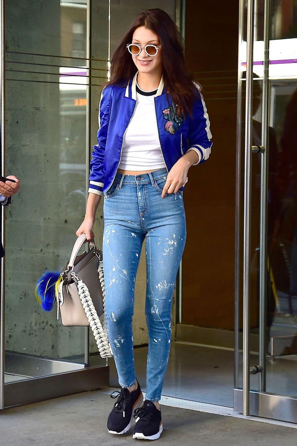 <p>In silk bomber, white tee, sneakers and jeans in Soho, New York City.</p>