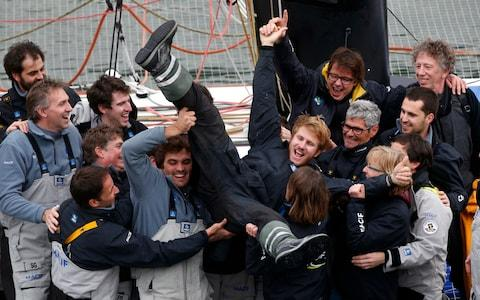 French skipper Francois Gabart celebrates his world record with his team, in the Brest harbor, western France, - Credit: Thibaut Camus/AP