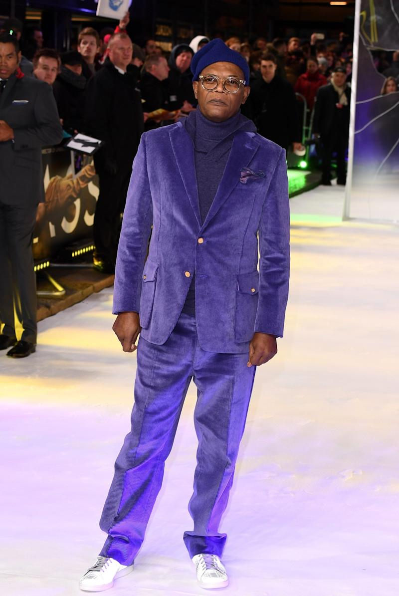 Rocking purple: Samuel L Jackson wore a vibrant suit for the premiere (Jeff Spicer/Getty Images)