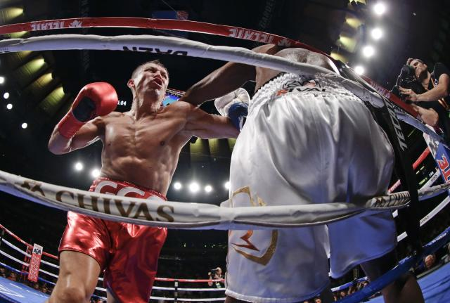 Kazakhstan's Gennady Golovkin, left, knocks down Canada's Steve Rolls during the fourth round of a super middleweight boxing match Saturday, June 8, 2019, in New York. Golovkin stopped Rolls in the fourth round. (AP Photo/Frank Franklin II)