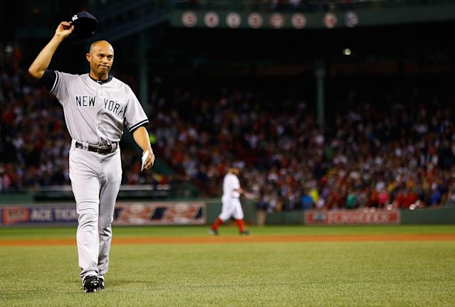 BOSTON, MA - SEPTEMBER 15: Mariano Rivera #42 of the New York Yankees tips his hat to the crowd after being honored prior to the game against the Boston Red Sox on September 15, 2013 at Fenway Park in Boston, Massachusetts. Tonight will be Rivera's final appearance at Fenway Park as he is set to retire at the end of this season. (Photo by Jared Wickerham/Getty Images)