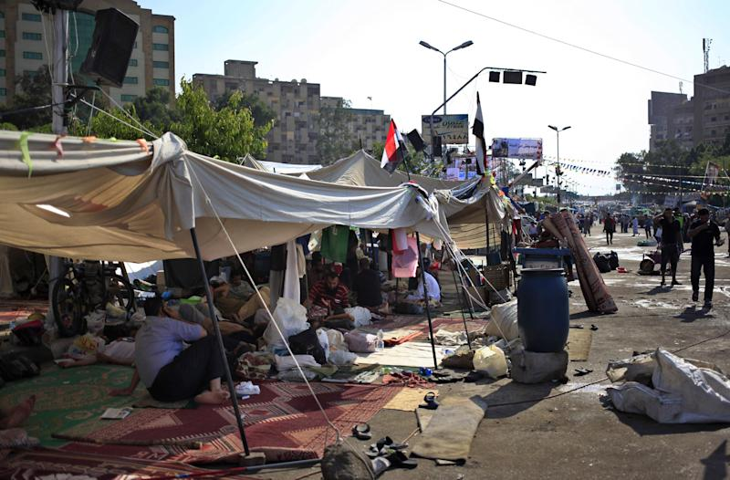 Supporters of ousted President Mohammed Morsi camp out in Nasr City in Cairo, Egypt, Thursday, July 18, 2013. Pro-Morsi protesters continued their sit-in in front of Rabaah al-Adawiya Mosque in Cairo for the third week. Residents of the area have complained blocking the roads and using nearby gardens for washing and sewage purposes. (AP Photo/Khalil Hamra)