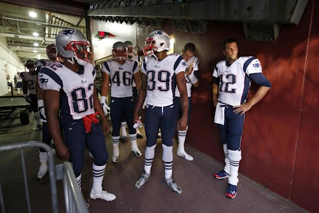 New England Patriots quarterback Tom Brady (12) stands in the tunnel with his teammates before heading out on to the field for an NFL football preseason game against the Washington Redskins in Landover, Md., Thursday, Aug. 7, 2014. Brandy was not expected to play during the game. (AP Photo/Alex Brandon)