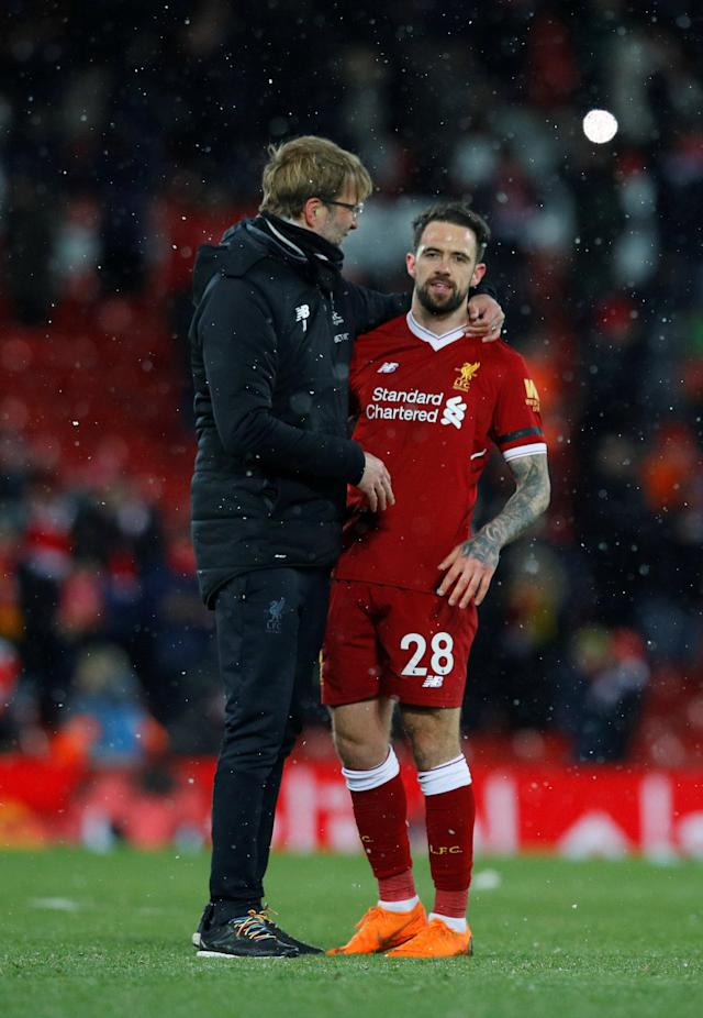 "Soccer Football - Premier League - Liverpool vs Watford - Anfield, Liverpool, Britain - March 17, 2018 Liverpool manager Juergen Klopp and Danny Ings celebrate after the match REUTERS/Phil Noble EDITORIAL USE ONLY. No use with unauthorized audio, video, data, fixture lists, club/league logos or ""live"" services. Online in-match use limited to 75 images, no video emulation. No use in betting, games or single club/league/player publications. Please contact your account representative for further details."