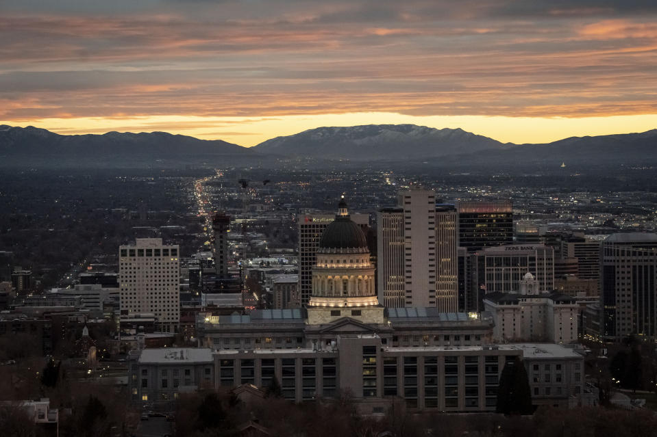The Utah State Capitol is illuminated against the setting sun in Salt Lake City, Sunday, Nov. 15, 2020. Utah is a place where right-wing Republicans have fought for the rights of undocumented immigrants and deeply religious legislators have enacted some of the nation's strongest protections for gays and lesbians. (AP Photo/Wong Maye-E)