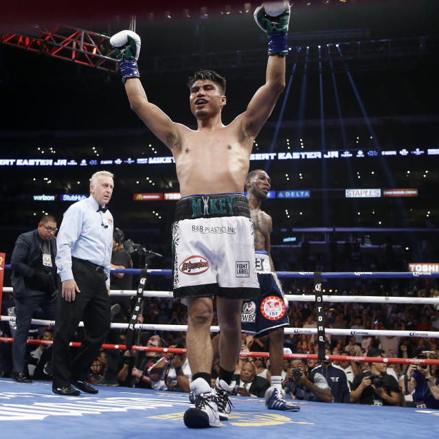 Mikey Garcia, left raises his fist after the WBC and IBF lightweight title bout against Robert Easter in Los Angeles, Saturday, July 28, 2018. Garcia won by unanimous decision. (AP Photo/Alex Gallardo)