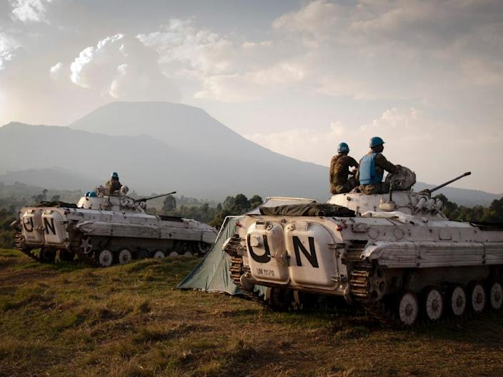 Indian soldiers of the United Nations mission in Democratic Republic of Congo (MONUSCO) sit on the top of tanks at a military post in Kibati, Democratic Republic of Congo, August 13, 2012 (AFP Photo/Michele Sibiloni)