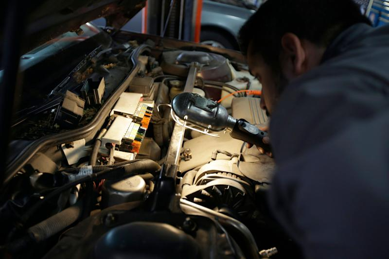 Mechanic Chris Geropoulos works on car, Wednesday, July 5, 2017, at Ted's Auto Clinic in Chicago. In looking for a mechanic, experts say it's a good idea to establish a relationship and find a repair shop you can trust, or you may risk big problems. Good old word-of-mouth still is probably the best way to pick a garage, says George Geropoulos, service adviser at Ted's Auto Clinic in northwest Chicago. (AP Photo/G-Jun Yam)