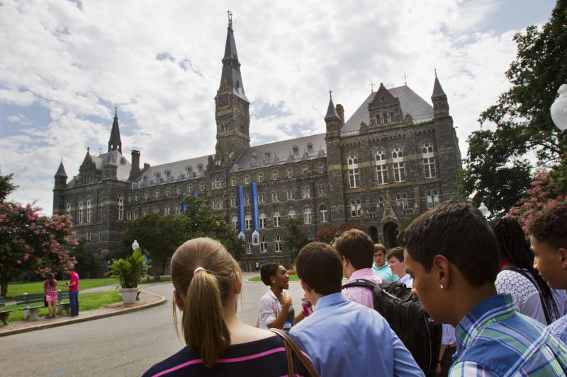 FILE - Prospective students tour Georgetown University's campus in Washington, in this Wednesday, July 10, 2013, file photo. Grants and scholarships are taking a leading role in paying college bills, surpassing the traditional role parents long have played in helping foot the bills, according to a report from loan giant Sallie Mae. (AP Photo/Jacquelyn Martin, File)