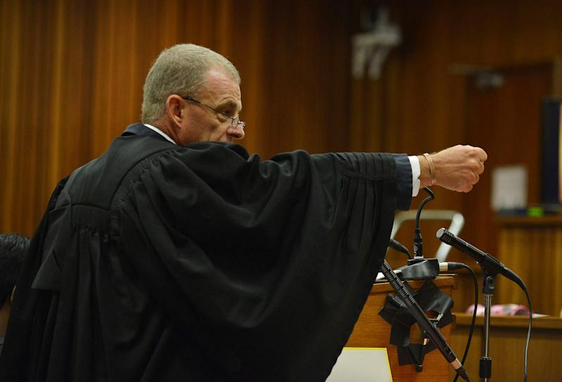 South African chief state prosecutor Gerrie Nel gestures as he explains a possible scenario into how Oscar Pistorius might have fired on girlfriend Reeva Steenkamp, in court in Pretoria, South Africa, Monday, April 14, 2014. A judge temporarily adjourned the murder trial of Oscar Pistorius after the athlete started to sob while testifying about the moments before he killed girlfriend Reeva Steenkamp in his home last year. (AP Photo/Antoine de Ras, Pool)