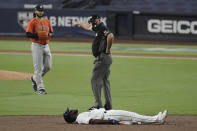 Second base umpire Jeff Nelson indicates to Tampa Bay Rays Randy Arozarena to get off the field after he was forced out by Houston Astros shortstop Carlos Correa during the third inning in Game 7 of a baseball American League Championship Series, Saturday, Oct. 17, 2020, in San Diego. (AP Photo/Jae C. Hong)