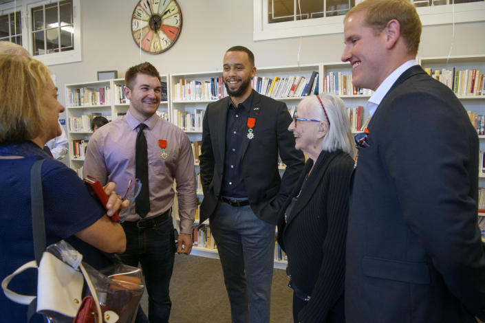 Alek Skarlatos, left, Anthony Sadler, Dorothy Eskel and her grandson Spencer Stone celebrate following a French Naturalization Ceremony for the three men in Sacramento, Calif., Thursday, Jan. 31, 2019. The three men were heralded as heroes when they subdued an armed terrorist on a train in France in 2015. Today they were granted French citizenship. (AP Photo/Randall Benton)