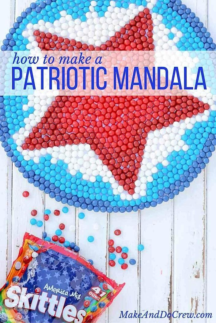 """<p>The most difficult part of this patriotic mandala craft is keeping yourself from eating all the Skittles before you finish. </p><p><strong><em>Get the tutorial from <a href=""""https://makeanddocrew.com/4th-july-craft-skittles-wreath/"""" rel=""""nofollow noopener"""" target=""""_blank"""" data-ylk=""""slk:Make & Do Crew"""" class=""""link rapid-noclick-resp"""">Make & Do Crew</a>.</em></strong></p>"""