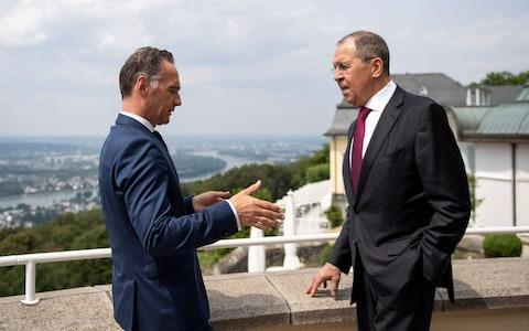 German Foreign Minister Heiko Maas and Russian Foreign Minister Sergey Lavrov talk ahead a German-Russian forum on Thursday - Credit: Marius Becker/AFP