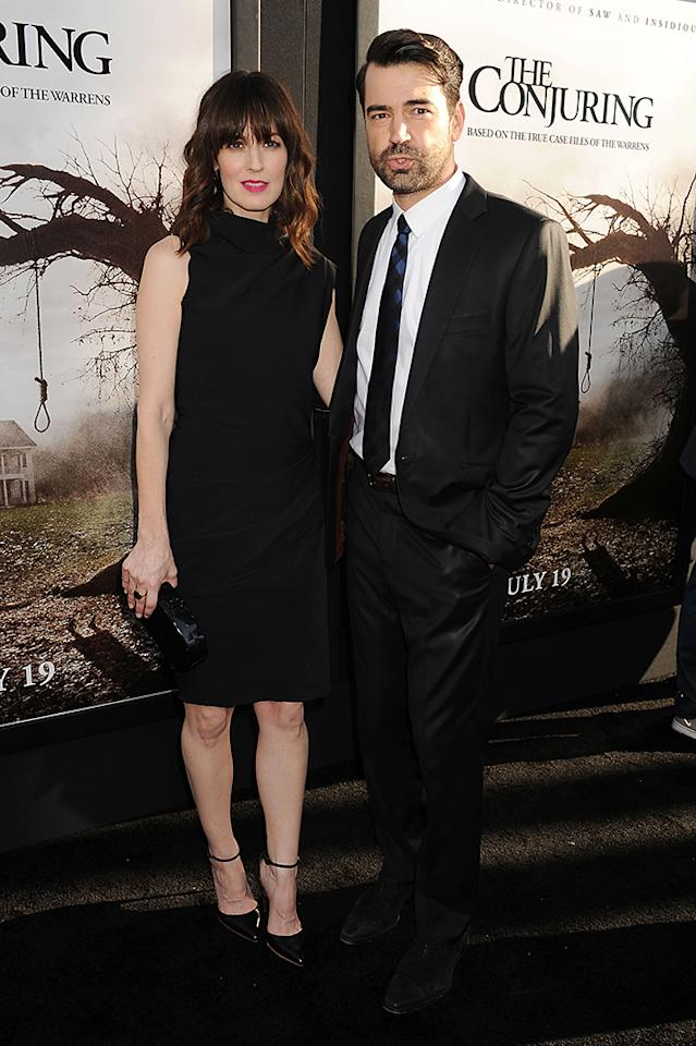 "HOLLYWOOD, CA- JULY 15: Actor Ron Livingston (R) and wife Rosemarie DeWitt arrive at ""The Conjuring"" Los Angeles Premiere at the ArcLight Cinemas Cinerama Dome on July 15, 2013 in Hollywood, California.(Photo by Jeffrey Mayer/WireImage)"