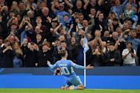 Jack Grealish celebrates scoring his first Champions League goal for Manchester City (AFP/Oli SCARFF)