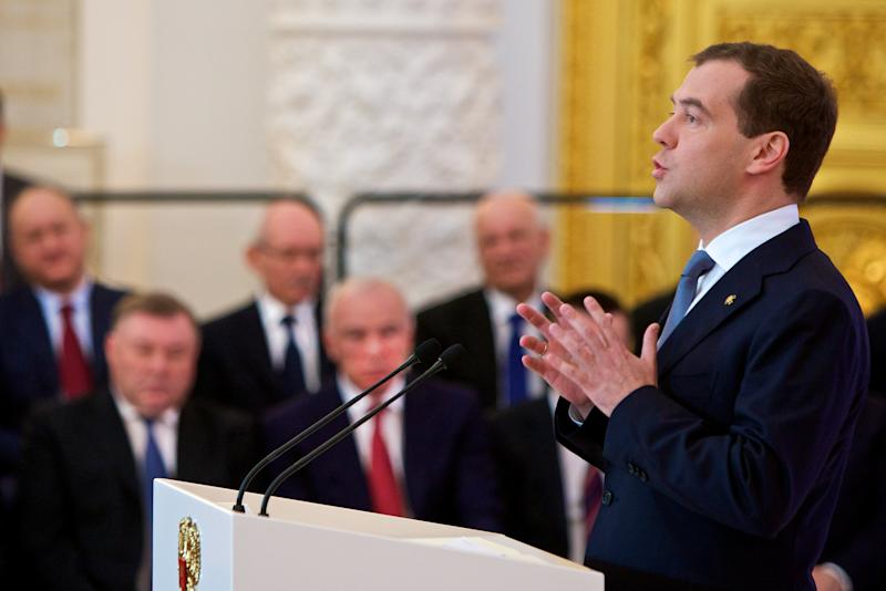 Russian President Dmitry Medvedev, right, addresses the State Council in the Kremlin in Moscow, Russia, Tuesday, April 24, 2012. Medvedev, who will shift into the prime minister's job after Vladimir Putin reclaims the presidency next month, summed up the results of his four-year presidency and set goals for the future.(AP Photo/Alexander Zemlianichenko)