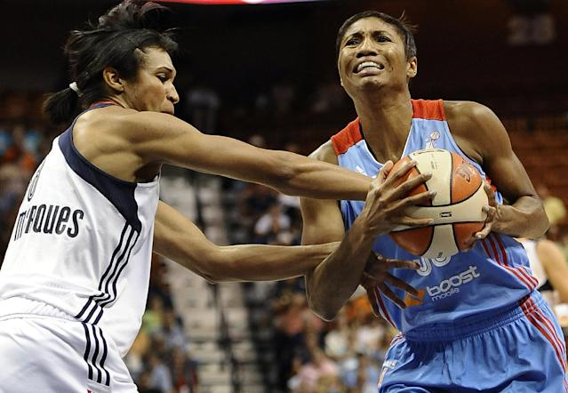 Connecticut Sun's Iziane Castro Marques, left, fouls Atlanta Dream's Angel McCoughtry during the first half of a WNBA basketball game in Uncasville, Conn., Wednesday, Aug. 14, 2013. (AP Photo/Jessica Hill)