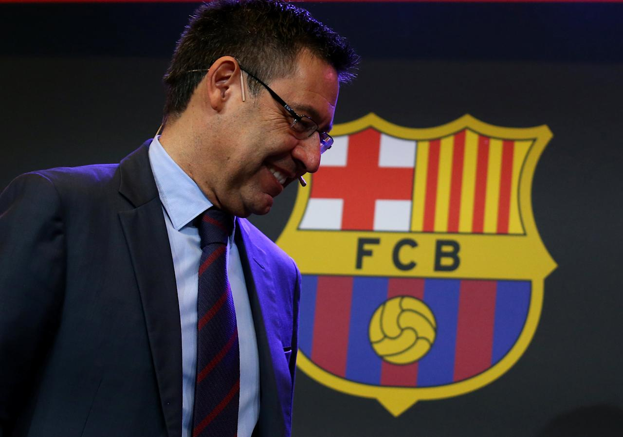 """Barcelona's President Josep Maria Bartomeu is seen next to a FC Barcelona's logo during a charity Christmas event """"Nujeen's dream"""" at Camp Nou stadium in Barcelona, Spain, December 14, 2017.  REUTERS/Albert Gea"""