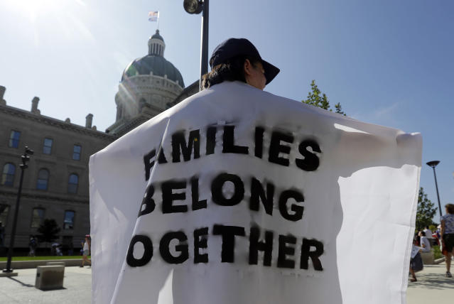 <p>Katy Heath holds a flag during a protest of the Trump administration's approach to illegal border crossings and separation of children from immigrant parents at the Statehouse, Saturday, June 30, 2018, in Indianapolis, Ind. (Photo: Darron Cummings/AP) </p>